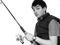 Photo of a quizzical young man holding a fishing pole