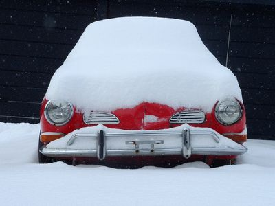 Snowed in red car